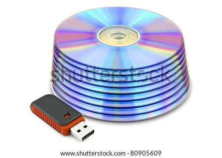 dvds and USB flash drive isolated on white