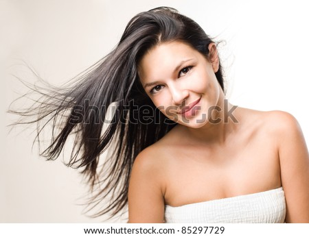 Dynamic beauty shot of gorgeous brunette with flowing hair. - stock photo