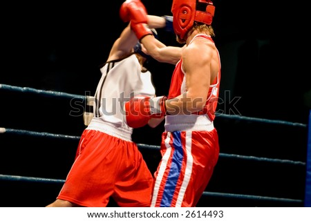 Dynamic boxing fight, two boxers fighting on the ring, focus on fighter arm,
