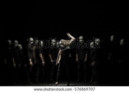 dynamic dance drama on stage in theater- theater group on stage  #576869707