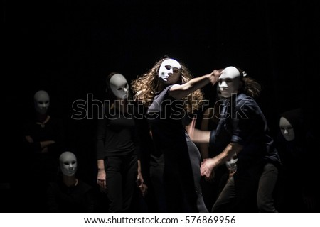 Photo of  dynamic dance drama on stage in theater- theater group on stage