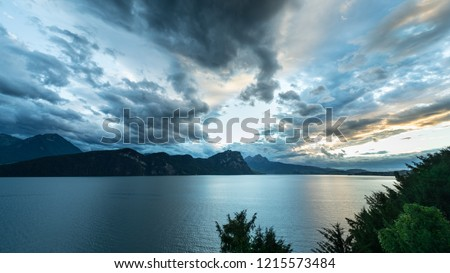 Dynamic landscape. Storm clouds over the mountains. Lake Lucerne. Panorama of the canton of Lucerne. Switzerland