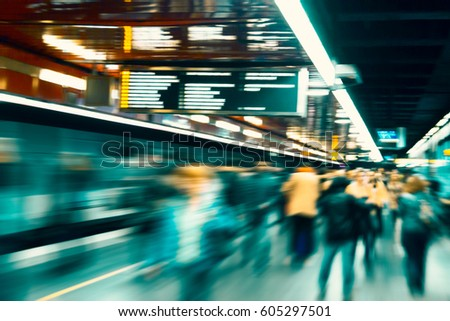 Dynamic photo of busy crowd of people walking, blurred motion. #605297501
