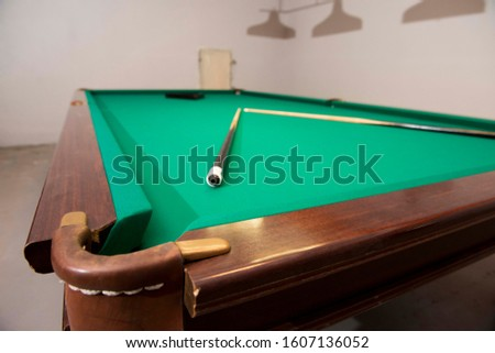Dynamic view of a Russian pool table with white balls pyramid,American pyramid,Dynamic pyramid,Siberian pyramid,Nevsky pyramid,Moscow pyramid games with the cue ball.
