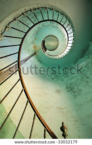 dynamic view on old hourtin lighthouse spiral staircase, france