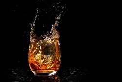 Dynamic Whiskey splash shot with space to add copy text or own branding or logo