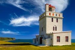 Dyrhólaeyjarviti - Dyrhólaey Lighthouse in a blue and cloudy sky day. Vík í Mýrdal, Iceland