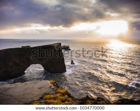 Dyrholaey rock formation at sunset. Dyrholaey is a promontory near Vik, Iceland #1034770000