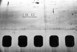 Dystopic image of the cabin windows on an old abandoned jet plane / aircraft. Concept of fear of flying or flying / aero phobia.
