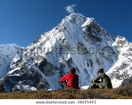 DZONGLA, NEPAL - OCTOBER 8: Unidentified hikers appreciating the view of Cholatse peak (6350M) on 8 October 2008 in Dzongla, Everest region, Nepal. This place is part of the Everest Base Camp Trek