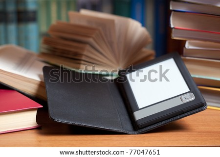 E-book and old books. New technologies in book publishing - stock photo