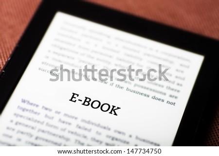 E-book on ebook, tablet pc concept