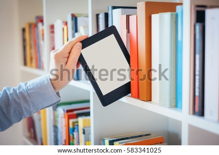E-book reader and colorful bookshelf