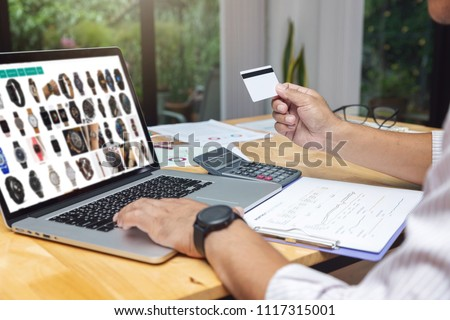 E-commerce concept, Businessman select item from website shoppping online and holding credit card