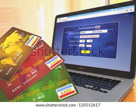 E-commerce. Credit cards on laptop. Three-dimensional image.