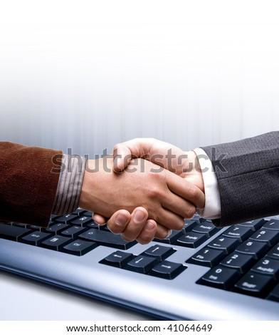 e-commerce handshake over technology background