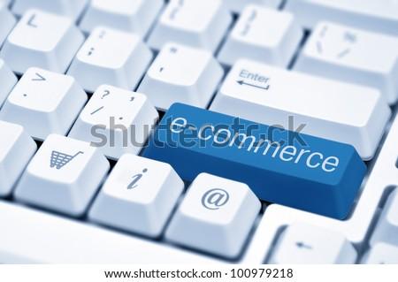 e-commerce key on a white keyboard closeup. E-commerce concept image.