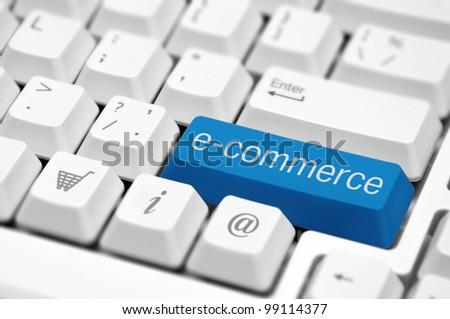 e-commerce key on a white keyboard closeup. E-commerce concept image. - stock photo