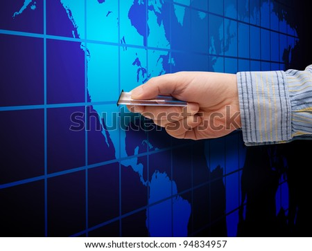E-Commerce: Mans Hand With Credit Card and Map of World
