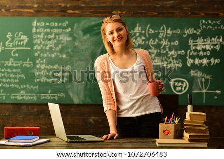 E-Learning concept with student holding his modern laptop computer, Tutor needs to be enthusiastic and needs to like his subject, Teacher drawing at classroom in school, #1072706483