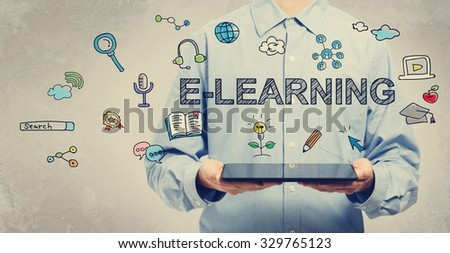 E-learning concept with young man holding a tablet computer  #329765123