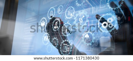 E-learning with connected gear cogs connected diagram virtual dashboard.business man hand working on laptop computer with digital layer business strategy and social media diagram on wooden desk
