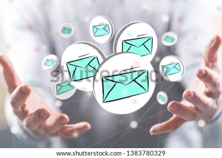 E-mail concept above the hands of a man in background