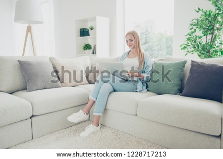 E-mail conversation with friend boyfriend concept. Beautiful attractive cute lovely sweet teen student she writer holding notebook on legs in casual style stylish outfit reading good news