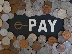 e-pay. word on chalkboard with pile of Japanese coins