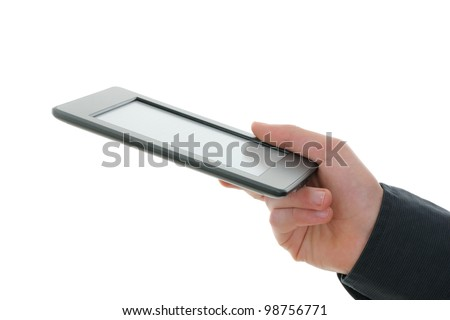 E-reader and hand. The reader is deprived of all brand names and buttons.