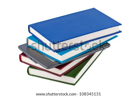 E-reader into a pile of books isolated on white background. - stock photo