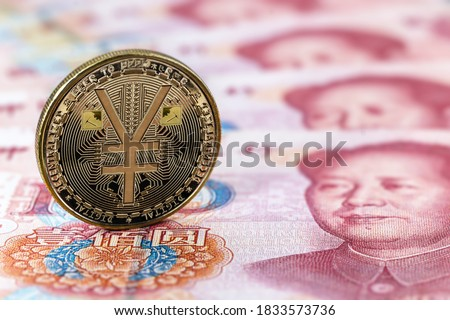 e-RMB gold coin, over 100 yuan banknotes, conceptual image of the digital version of the yuan. Chinese decentralized currency