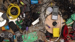 E-waste and Hazardous waste sorting and disposal. Old broken phones, battery, computers and electronics. Heavy metal pollution. Used electrical devices and obsolete electronic equipment