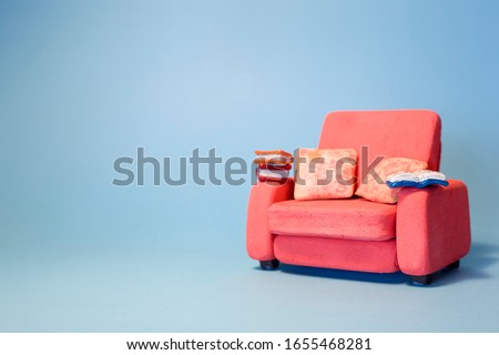 eading a book on the sofa inside the room