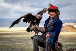 Eagle Hunter with his golden eagle in Bayan Olgii, West Mongolia.