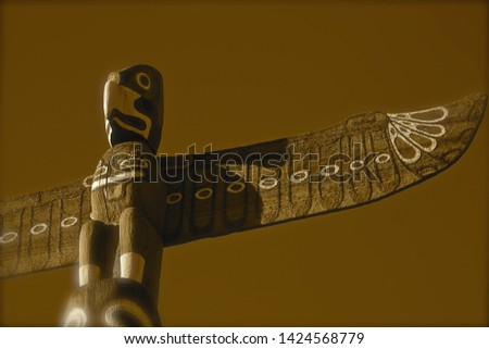 eagle on top of American totem pole