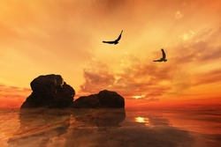 Eagles flying over rocks with a beautiful orange sunset