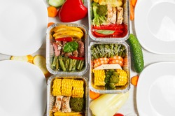 ealthy meal prep containers with vegetables, chicken, beef and shrimp grilled. Close-up, view top.