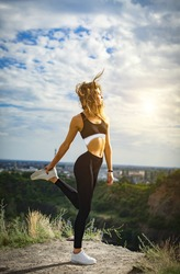 ealthy sports lifestyle. Athletic young woman in sports dress doing fitness exercise. Fitness woman on stadium.