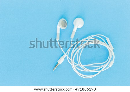 ear buds or earphones on green background