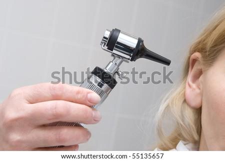 Ear exam - stock photo