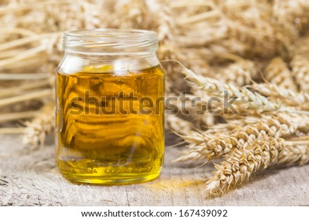 ear of wheat and  oil