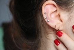 ear piercings photos.Helix piercing.Ear rings