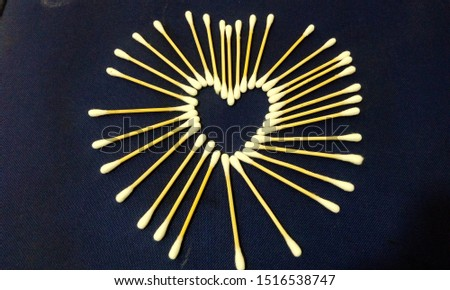 Ear wax cleaning Ear Buds forming together to make Heart Symbol as a sign of love with health of ear