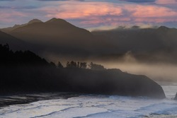 Early foggy morning sunrise at the Bay at Ecola State Park near Canon Beach on the Oregon coast