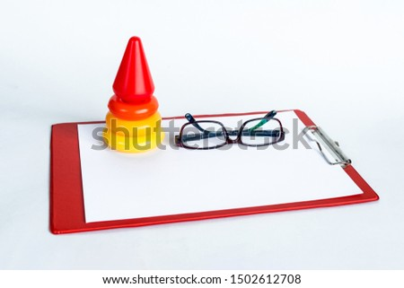 Early learning. Colorful geometric logic toy for geeks pyramid isolated on white background. Children's educational and educational games. Teacher's blackboard and glasses. Copy space