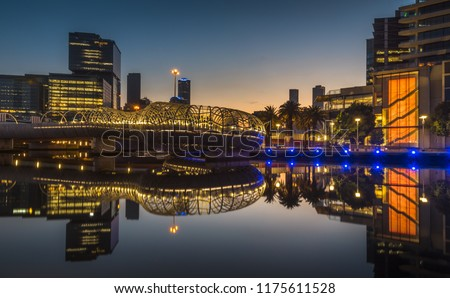 early morning Dawn reflections south wharf docklands Melbourne city skyline clear calm