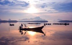 Early morning fishing boat navigation lamps,Fishermen fishing in the early morning golden light,Fisherman boat,Fisherman net.Photo Fisherman Silhouette, Ban Sam Chong Tai Village,Southern of Thailand