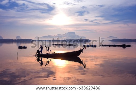 Shutterstock Early morning fishing boat navigation lamps,Fishermen fishing in the early morning golden light,Fisherman boat,Fisherman net.Photo Fisherman Silhouette, Ban Sam Chong Tai Village,Southern of Thailand