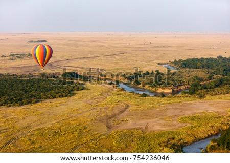 Early morning flight of hot balloons over Masai Mara national park, Kenya